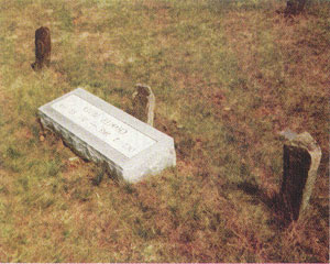 Charlie Silver's original three graves along with a new marker.